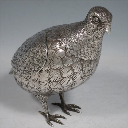A Sterling Silver large cast model of a partridge bird, having realistically hand-chased feathers, a pull-off head, and hinged wings. Imported and having hallmarks for London in 1925. The dimensions of this fine hand-made silver partridge model are height 16.5 cms (6.5 inches), length 16.5 cms (6.5 inches), width 9 cms (3.5 inches), and it weighs approx. 435g (14 troy ounces).