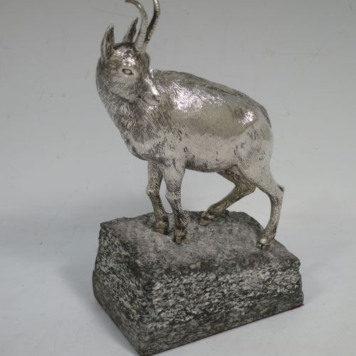A very handsome Sterling Silver cast model of an Ibex mountain goat, mounted on a piece of grey granite. Made by Holland and Holland of London in ca. 1970. The dimensions of this hand-made silver mountain goat Ibex are height (inc. granite mount) 20 cms (8 inches), and length 13 cms (5 inches).