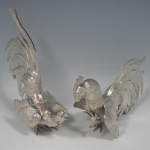 Sterling silver pair of fighting cocks with import marks for London 1975. Length 22 cms (8.5 inches), height 20 cms (8 inches). Weight approx. 19 troy ounces.