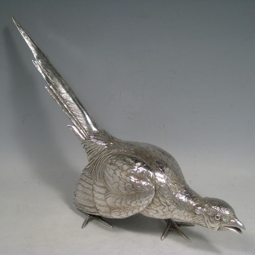 Sterling silver large cast model of a pheasant cock bird, having realistically hand-chased feathers. Imported and having hallmarks for London in 1926. Height 21.5 cms (8.5 inches), length 35 cms (13.75 inches), width 8 cms (3 inches). Weight approx. 412g (13.3 troy ounces).