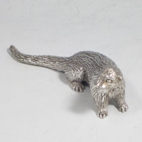 Sterling silver cast model of an otter, having a realistically hand-chased fur body. Made in London in 1993. The dimensions of this fine hand-made silver otter model are length 10 cms (4 inches), height 3.5 cms (1.3 inches), and it weighs approx. 196g (6.3 troy ounces).