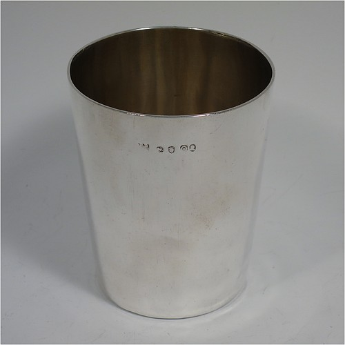 A rare 18th century Antique Georgian Sterling Silver beaker cup, having a very plain round body with tapering sides, sitting on a flat base, and with a gold-gilt interior. Made by Philip Batchelor (poss.) of London in 1789. The dimensions of this fine hand-made antique silver beaker cup are height 9 cms (3.5 inches), diameter at top 7.5 cms (3 inches), and it weighs approx. 116g (3.7 troy ounces).