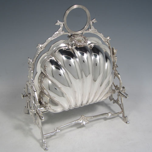 Antique Victorian silver plated folding biscuit box, having a plain shell-style body sitting in a cast frame designed with peacocks heads, and with original interior hand-pierced dividers. Made in ca. 1880. The dimensions of this fine hand-made silver-plated folding biscuit box are height 25.5 cms (10 inches), length fully opened 33 cms (13 inches), and width 22 cms (8.75 inches).