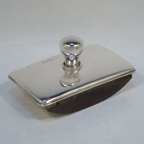 A very handsome Antique Edwardian Sterling Silver rocker blotter, having a very plain rectangular body with rounded corners, a leather covered rocker base, and a plain round handle that screws in to secure the rocker base and blotting paper to the upper body. Made by Henry Matthews of Birmingham in 1905. The dimensions of this fine hand-made antique silver rocker blotter are length 12 cms (4.75 inches), height 6 cms (2.3 inches), and width 7.5 cms (3 inches)