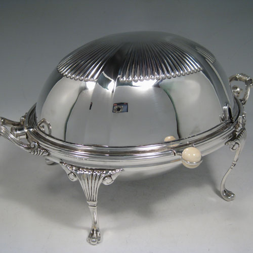 Antique Victorian silver-plated breakfast dish with revolving lid, original liners, and having hand-chased half-fluted body, sitting on four cast fluted feet. Made by the Mappin Brothers of Sheffield in ca. 1890. Height 21 cms (8.25 inches), length 35.5 cms (14 inches), width 21.5 cms (8 inches).