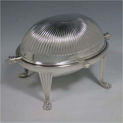 An Antique Victorian Silver Plated revolving top butter dish, having a hand-chased oval body with fluted decoration and bead-edged border, a frosted glass removable internal liner, and sitting on four cast lions paw feet. All made by Alexander Clark & Co., in ca. 1890. The dimensions of this fine hand-made antique silver-plated butter dish are length 22 cms (8.75 inches), height 14 cms (5.5 inches), and width 15 cms (6 inches).
