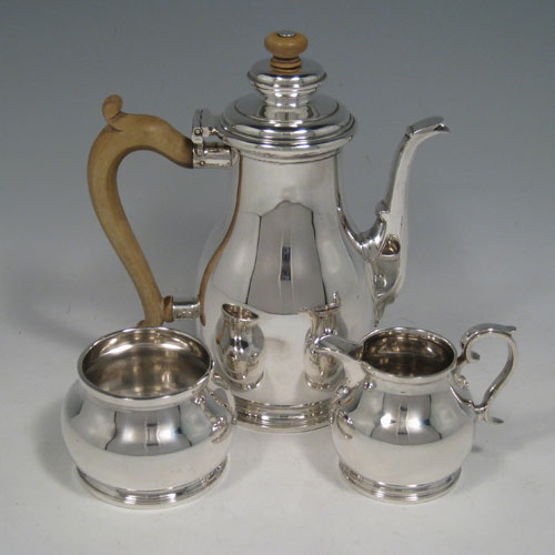 Sterling silver three-piece coffee set with coffee pot, sugar bowl, and cream jug. Made by Robert Comyns of London in 1936. Height of coffee pot 10 cms (7 inches), length of coffee pot 16 cms (6.25 inches). Total weight approx. 19 troy ounces (589g).