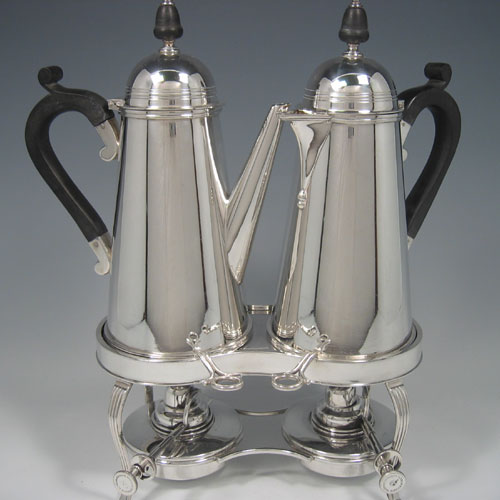 A very unusual silver plated cafe-au-lait set sitting on a double burner stand, made in ca. 1930. Height 34 cms (13.5