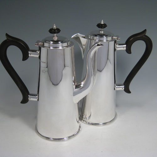 Sterling silver pair of straight-sided cafe-au-lait pots made by James Dixon of Sheffield in 1975. Length of coffee pot 20 cms (8 inches), height 23 cms (9 inches). Total weight approx. 32 troy ounces (992g).