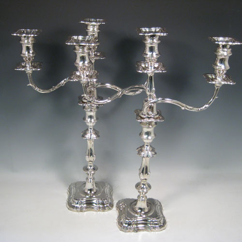 Antique Edwardian sterling silver pair of three-light candelabra with removable arms, plain baluster bodies with cut-corner borders, and original removable nozzles. Made by Fordham and Faulkner of Sheffield 1905. Height 50 cms (19.75 inches), spread across branches 38.5 cms (14.3 inches).