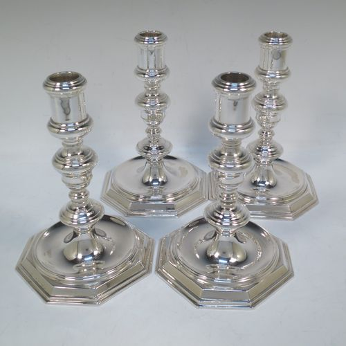 A very elegant set of four cast Sterling Silver candlesticks in a George I style, having plain round baluster bodies, and sitting on plain octagonal bases. Made by Goldsmiths and Silversmiths of Sheffield in 1931. The dimensions of this fine set of hand-made silver table candlesticks are height 19 cms (7.5 inches), the bases are 12.5 cms (5 inches) square, and the total weight is 1,602g (52 troy ounces)