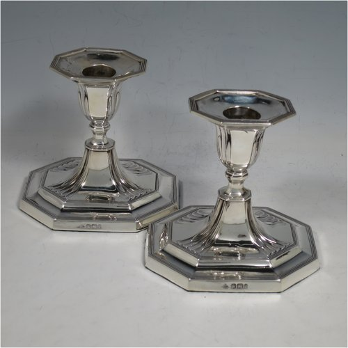 An Antique Victorian Sterling Silver pair of small candlesticks, having octagonal bases with hand-chased  fluted decoration, reed-edged borders, and removable nozzles. Made by Martin & Hall of Sheffield in 1901. The dimensions of these fine hand-made antique silver candlesticks are height 10 cms (4 inches), and the bases are 11 cms (4.3 inches) long, by 8.5 cms (3.3 inches).