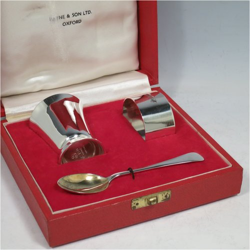 A Sterling Silver christening set, having an egg cup with gold-gilt interior, a spoon with gold-gilt bowl, and a napkin ring. All in a very plain style, and sitting in their original satin and velvet-lined red presentation box. Made by Payne & Son Ltd., of London in 1971/73. The dimensions of this fine hand-made silver christening set are length of spoon 11 cms (4.3 inches), height of egg cup 6 cms (2.25 inches), diameter of napkin ring 4.5 cms (1.75 inches), and the total weight is approx. 97g (3 troy ounces).