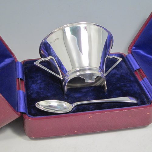 Sterling silver Art Deco christening set consisting of a two-handled bowl and spoon in original blue satin and velvet-lined presentation box. Made by James Dixon & Sons of Sheffield in 1912. The dimensions of this fine hand-made silver christening set are diameter of bowl 10 cms (4 inches), length of spoon 14 cms (5.5 inches), and with a total weight of approx. 187g (6 troy ounces).