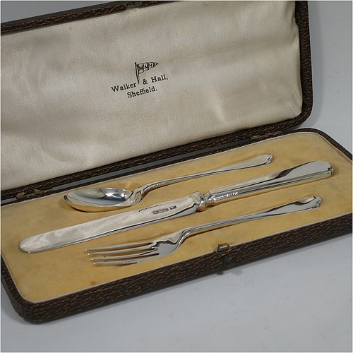 A very handsome Art Deco style Sterling Silver christening set, having a knife, fork, and spoon, all sitting in their original white satin and cream velvet-lined presentation box. Made by Walker and Hall of Sheffield in 1932. The dimensions of this fine hand-made silver christening set are length of knife 19 cms (7.5 inches), with a total weight of approx. 93g (3 troy ounces).