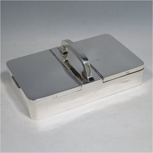 An Antique Edwardian Sterling Silver partners table cigar / cigarette box, having a plain rectangular body, with double hinged compartments, and a carrying handle, with cedar wood-lined interiors. Made by William Neale of Chester in 1903. The dimensions of this fine hand-made silver table cigarette or cigar box are length 18 cms (7 inches), width 10 cms (4 inches), height inc. handle 6 cms (2.5 inches). Please note that there is a small dent in the handle.