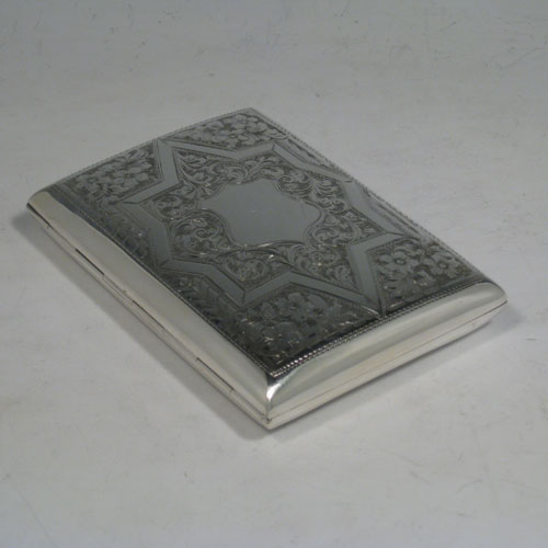 Antique Edwardian sterling silver cigarette / cigarello case, having a rectangular shaped body with rounded edges, hand-engraved floral and geometrical style decoration, central vacant cartouche, and thumb-piece with catch. Made in Chester in 1909. The dimensions of this fine hand-made silver cigar case are length 11.5 cms (4.5 inches), width 8.5 cms (3.3 inches), depth 2 cms (0.75 inch), and the weight is approx. 143g (4.6 troy ounces).
