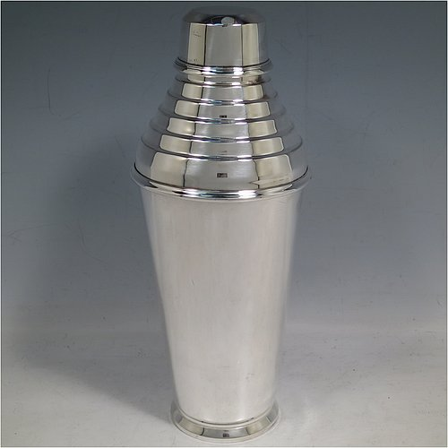 A Silver-Plated Art Deco cocktail shaker, having a plain round body with tapering sides, with a pull-off lid and a stepped strainer section. Made by Wilson & Sharp of Edinburgh, Scotland, in ca. 1930. The dimensions of this fine hand-made silver plated cocktail shaker are height 24 cms (9.5 inches), diameter at widest point 9.5 cms (3.75 inches).