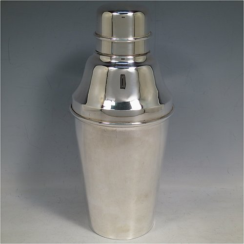 A large sized Silver-Plated Art Deco cocktail shaker, having a plain round body with tapering sides, with a pull-off lid and strainer section. Made in ca. 1930 The dimensions of this fine hand-made silver plated cocktail shaker are height 24 cms (9.5 inches), diameter at widest point 11 cms (4.25 inches).