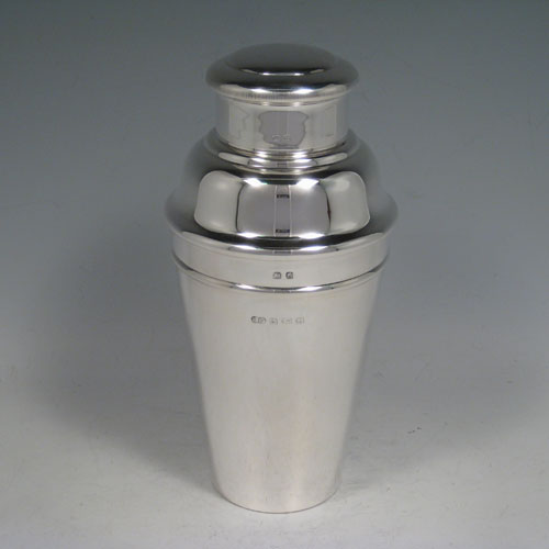 Sterling silver very plain cocktail shaker with removable lid and strainer section. Made by Suckling Ltd., of Birmingham in 1931. Height 20 cms (8 inches), diameter at widest point 9.5 cms (3.75 inches). Weight approx. 340g (11 troy ounces).
