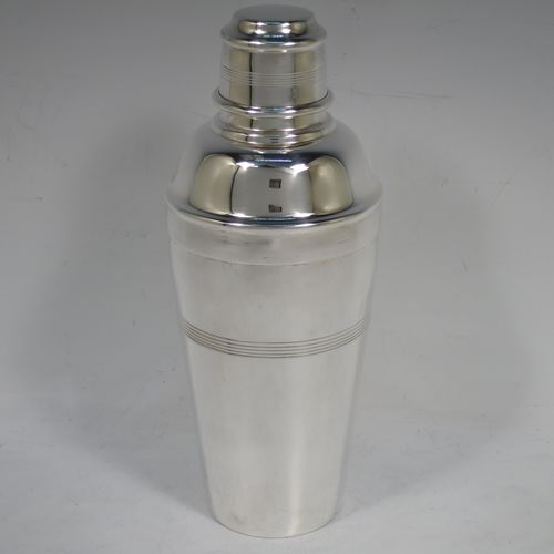 A handsome Silver-Plated Art Deco cocktail shaker, having a plain round body with tapering sides and hand-egraved bands of horizontal reeded decoration, a pull-off lid with knurled border, together with a pull-off strainer section, and the main body with a flat base. Made by Charles Boyton and Sons of Sheffield, England, in ca. 1930. The dimensions of this fine hand-made silver plated cocktail shaker are height 21.5 cms (8.5 inches), diameter at widest point 8.5 cms (3.3 inches).