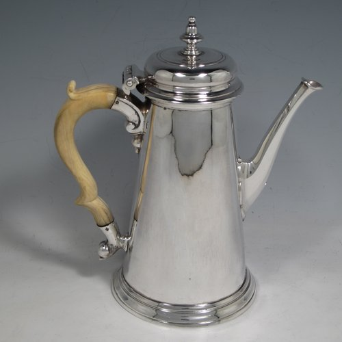 Antique Georgian sterling silver George II coffee pot, having a plain round body with straight tapering sides, a hinged cushion style lid with finial, an octagonal panelled spout, an ivory scroll handle, and all sitting on a collet foot. Made by John Swift of London in 1738. The dimensions of this fine hand-made silver coffee pot are length 18 cms (7 inches), height 20 cms (8 inches), and it weighs approx. 625g (20 troy ounces). Please note that this item shows fire-stain which is acceptable for a piece from this period.