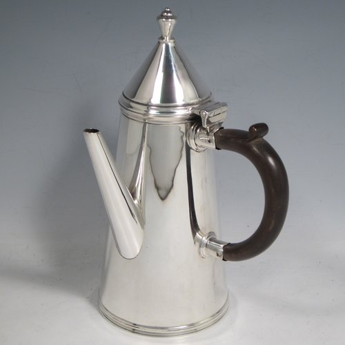 Antique Sterling silver fine hand-made William & Mary style coffee pot, having a very plain round body with tapering sides, a conical hinged lid with finial, a straight spout, and a wooden looped side-handle, all sitting on a raised base. Made by Thomas Bradbury & Sons of London in 1911. The dimensions of this fine silver coffee pot are length 12 cms (4.75 inches), height 22 cms (8.5 inches), and it weighs approx. 400g (13 troy ounces).