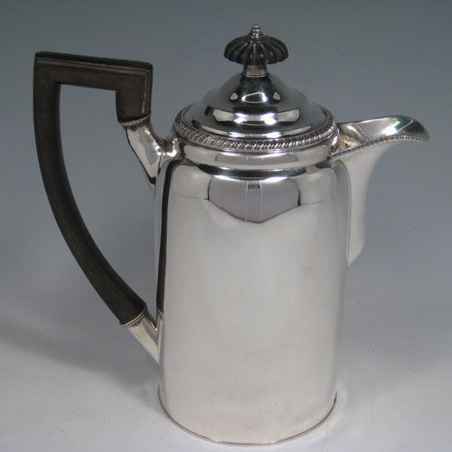 Antique Georgian sterling silver coffee Biggin pot with pull-off lid. Please note that this item is missing its original burner stand. Made by Thomas Johnson of London in 1804. Length 19 cms (7.5 inches), height 20 cms (8 inches), diameter 10 cms (4 inches). Weight approx. 16 troy ounces (496g).