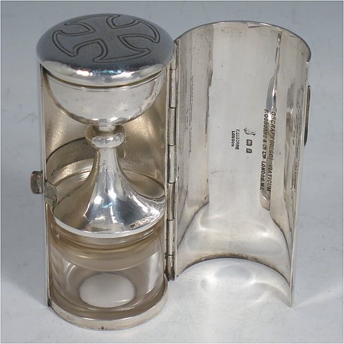 A rare Sterling Silver three-piece travelling communion set consisting of a hand-hammered chalice, pyx box with lid, and glass wine holder with stopper, all in their original silver cylindrical hinged travelling box with a hand-chased christogram. Made by Frederick Osborne & Co., of London in 1930. The dimensions of this fine hand-made silver travelling communion set are length of box 9.5 cms (3.75 inches), and diameter 4.5 cms (1.75 inches), and with a total weight of approx. 250g (8 troy ounces). Please note that it is very unusual to find an original pyx box in a travelling communion set.