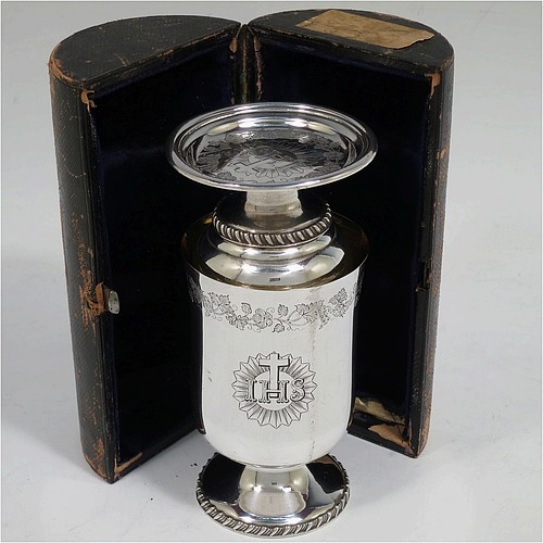 A very unusual and handsome Antique Victorian Silver Plated three-piece travelling communion set consisting of a chalice, paten, and wine bottle. The chalice having a round body with a gold-gilt interior, and sitting on a pedestal foot with a gadroon border. The paten having a round body sitting on a pedestal foot with a gadroon border. The wine bottle having a round body with a flat base and screw-off corked lid. All three pieces are hand-engraved with Christograms and a band of grapevine decoration, and sit in their original dark blue velvet-lined presentation box. All made in ca. 1848, with a contemporaneous inscription on the chalice. The dimensions of this fine hand-made antique silver-plated travelling communion set are height of chalice 10 cms (4 inches), diameter of paten 6.5 cms (2.5 inches), and height of bottle 9.5 cms (3.75 inches).