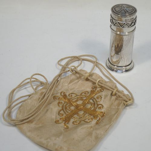 A beautiful Arts and Crafts style Sterling Silver travelling communion set with hand-hammered decoration, consisting of a cylindrical body holding a crystal body for the consecrated wine, together with an upper wafer pyx box attached to the lower body with a bayonet fit and having applied rope-twist decoration, together with a pull off lid with a hand-chased Christogram on top and a gold-gilt interior. Made by Greenwood and Watts of London in 1917. The dimensions of this fine hand-made antique silver travelling communion set are height 9 cms (3.5 inches), diameter 4 cms (1.5 inches), with a total weight of approx. 68g (2.2 troy ounces). Please note that this also comes with its own cream silk and gold embroidered string-draw carrying pouch.