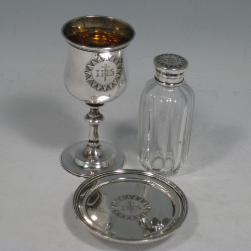 Antique Victorian sterling silver three-piece travelling communion set consisting of chalice, paten, and wine bottle (with screw-thread lid and stopper), all hand-engraved with a christogram. Made by Charles Reily and George Storer of London in 1844. The dimensions of this fine hand-made silver communion set are height of chalice 9.5 cms (3.75 inches), diameter of paten 7 cms (2.75 inches), and the total weight is approz. 110g (3.5 troy ounces).