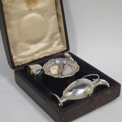 A handsome Antique Edwardian Sterling Silver three-piece travelling communion set consisting of chalice, paten, and wine flagon. In a plain round style, having a gold-gilt interior to the chalice,  an amphora style flagon, and a paten with an applied border and pedestal foot. All the pieces sit in their original cream satin and blue velvet-lined presentation box. Made by Thomas Wooley of Birmingham in 1902. The dimensions of this fine hand-made antique silver travelling communion set are height of flagon 9.5 cms (3.75 inches), diameter of paten 6 cms (2.5 inches), and with a total weight of approx. 113g (3.6 troy ounces). Please note that all items are engraved with a Christogram, and that the flagon does not have a stopper.