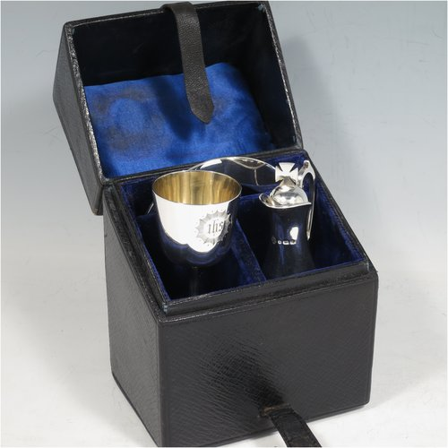 An Antique Victorian Sterling Silver three-piece travelling communion set consisting of chalice, paten, and wine ewer (with pull-off lid and cork seal), having plain round baluster bodies, the chalice with a gold-gilt interior, all having engraved christograms and in their original leather upright presentation box with dark blue velvet and satin-lined interior. Made by Martin & Hall of Sheffield between 1888 to 1890. The dimensions of this fine hand-made antique silver travelling communion set are height of ewer 11 cms (4.25 inches), diameter of paten 8 cms (3.25 inches), and with a total weight of approx. 155g (5 troy ounces).