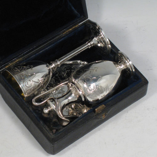 Antique Victorian sterling silver three-piece travelling communion set consisting of chalice, paten, and wine ewer (with lid and cork seal), all hand-engraved with floral work, in original velvet and satin-lined presentation box. Made by George Richards of London in 1856. Height of chalice 10 cms (4 inches), diameter of paten 7 cms (2.75 inches). Total weight approz. 154g (5 troy ounces).