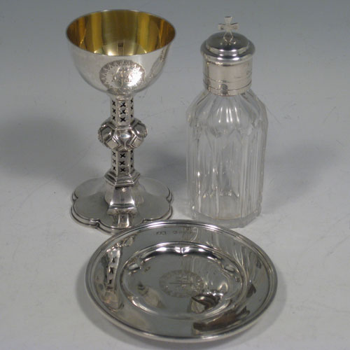 Antique Victorian sterling silver three-piece travelling communion set consisting of chalice, with unusual pierced stem, paten, and wine bottle with pull-off lid and internal stopper. Made by Joseph Barnard of London in 1883. Height of chalice 9 cms (3.5 inches), diameter of paten 8.5 cms (3.25 inches). Total weight approx. 100g (3.2 troy ounces).
