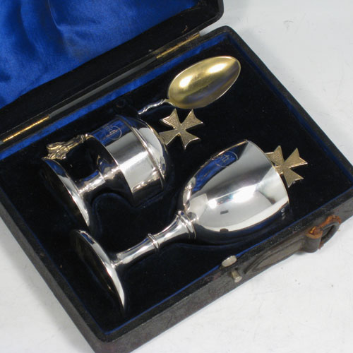 Antique Victorian Scottish sterling silver three-piece travelling communion set consisting of a covered chalice, an annointing spoon, and a ciborium, in original velvet and satin-lined presentation box. Both the chalice and ciborium have sealed lids with cast gold-gilt cruciform handles. The chalice is engraved with Sanguis Christi (blood of Christ), and the ciborium with Corpus Christi (body of Christ). The spoon has a gold-gilt bowl, twisted stem, and a cast figure of Christ. The chalice was made in Edinburgh in 1872, whereas the Ciborium and spoon were made in Glasgow in 1867. Height of chalice 13 cms (5 inches), length of spoon 12 cms (4.75 inches). Total weight approz. 183g (5.9 troy ounces).