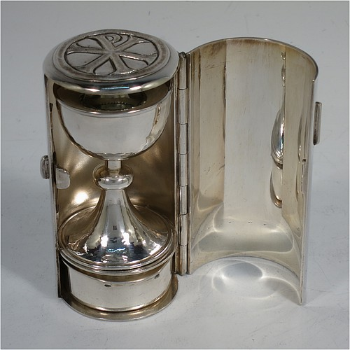 A lovely Arts and Crafts style Sterling Silver travelling communion set, consisting of a chalice with pull-off lid and gold-gilt interior, a pyx box with hinged lid and gold-gilt interior, all fitted into a silver-plated cannister style hinged holder with a push-button latch and an applied christogram on top. Made by Leonard William Burt of London in 1966. The dimensions of this fine hand-made silver travelling communion set are length of cannister 9 cms (3.5 inches), height of chalice with lid 6.5 cms (2.5 inches), diameter of pyx box 4 cms (1.5 inches), with a total weight of approx. 89g (2.9 troy ounces).