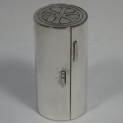 A lovely Arts and Crafts style Sterling Silver travelling communion set with hand-hammered decoration, consisting of a chalice with pull-off lid and gold-gilt interior, the lid also acting as a paten, a pyx box with hinged lid and gold-gilt interior, all fitted into an original silver cannister style hinged holder with a push-button latch and an applied Christogram on top. Made by Greenwood and Watts  of London in 1927. The dimensions of this fine hand-made silver travelling communion set are length of cannister 8.5 cms (3.25 inches), height of chalice with lid 6.5 cms (2.5 inches), diameter of pyx box 3.5 cms (1.3 inches), with a total weight of approx. 212g (6.8 troy ounces). Please note that this item has an In Memorium inscription engraved on the inside of the cannister.