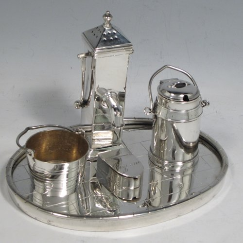 Antique Victorian silver plated condiment set, having a very unusual and rare design, showing the pepper pot as a water pump stand, the mustard pot as a milk churn, the salt cellar as a water pail, and a separate box with lid marked for cayenne. All sitting on an oval base made to look like a tiled kitchen floor. With a Diamond Registration mark for 28th May 1882. The dimensions of this fine hand-made silver-plated condiment set are length 15 cms (6 inches), height 11 cms (4.3 inches), and width 12 cms (4.75 inches).