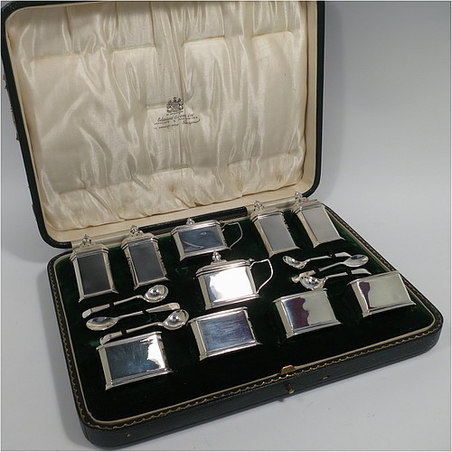 A Sterling Silver Art Deco ten piece condiment service, having octagonal straight-sided bodies, with original blue-glass liners, pull-off lids on the peppers, hinged lids on the mustards, and all in original green velvet and cream satin-lined presentation box. Consisting of two mustard pots, four pepper pots, four salt cellars, and six condiment spoons. Made by Edward and Sons of Birmingham in 1927. The dimensions of this fine hand-made sterling silver condiment service are height of peppers 7 cms (2.75 inches), length of mustard 6.5 cms (2.5 inches), and a total weight of approx. 323g (10.4 troy ounces). Please note that the silver condiment spoons are hallmarked new.
