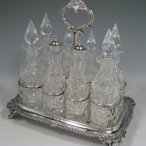 Antique Georgian sterling silver and hand-cut crystal eight-bottle cruet set, made by Robert Hennell II of London in 1833. Please note that the silver lids on the two shaker bottles are not marked. Length 27 cms (10.5