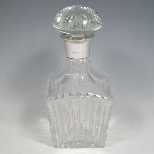 Sterling silver and hand-cut crystal decanter, having a square cross-section body with tapering sides, hand-cut fluted decoration, a silver collar with lip, and original fluted stopper. Made by Barker Brothers Ltd., of Birmingham in 1939. The dimensions of this fine silver and crystal decanter are height 23 cms (9 inches), and width 10 cms (4 inches).