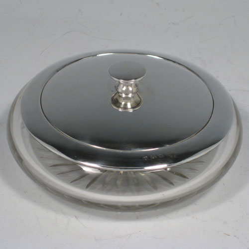 Sterling silver and hand-cut crystal dressing table jar with pull-off lid, with integral vanity mirror positioned under lid. Made by the Adie Brothers of Birmingham in 1937. Diameter 11.5 cms (4.5 inches), height 5 cms (2 inches).