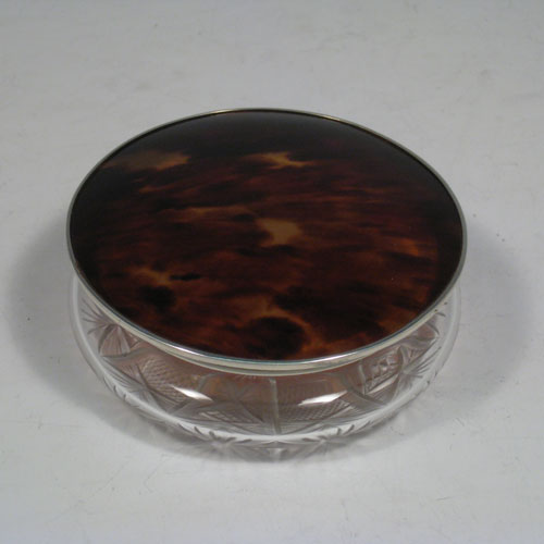 Sterling silver and tortoise-shell dressing table jar with pull-off lid and hand-cut crystal body. Made in Birmingham in 1925. Diameter 10 cms (4 inches), height 4 cms (1.5 inches).