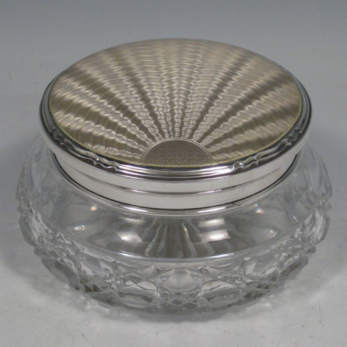 Sterling silver and hand-cut crystal dressing table jar, with enamelled 'sun-burst' lid. Made in Birmingham in 1928. Diameter 13 cms (5 inches), height 7 cms (2.75 inches).