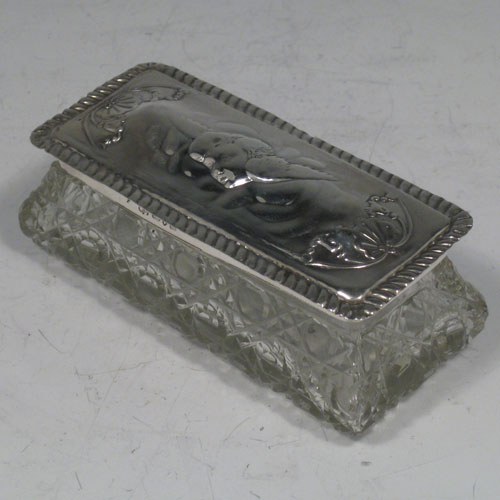 Antique Victorian sterling silver hand-chased and cut-crystal dressing table box made by the Deakin Brothers of Chester in 1901. Length 11 cms (4.25 inches), width 5 cms (2 inches), height 4.5 cms (1.75 inches).