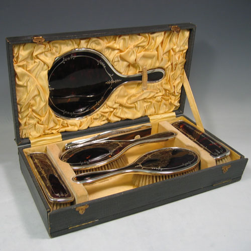 Sterling silver and inlaid tortoise-shell dressing table set with six pieces in original box. Made by W.G. Sothers & Co., of Birmingham in 1923. Length of mirror 26 cms.