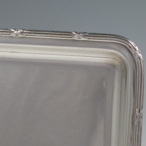 Sterling silver very plain rectangular dressing table tray with ribbon and reed border. Length 27 (10.75 inches), width 21.5 cms (8.5 inches). Weight 16 troy ounces (496g).