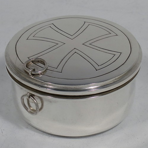 A large Sterling Silver Pyx box, having a plain round body, a hinged and reeded lid with a hand-engraved Christogram, with two rings for a carrying chain, a gold-gilt interior, and sitting on a flat base. Made by Burns, Oats and Washbourne of London in 1936. The dimensions of this fine hand-made silver Pyx box are diameter 7 cms (2.75 inches), depth 3.5 cms (1.3 inches), and it weighs approx. 81g (2.6 troy ounces).